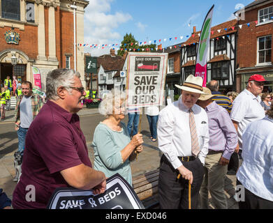 Henley-on-Thames, UK. 11th July, 2015. An elderly woman taking part in a demonstration carries a placard for the - Stock Photo