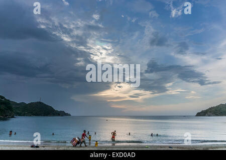 Evening on the beach at Taganga near Santa Marta, Colombia.  The once small fishing village on the Caribbean has - Stock Photo
