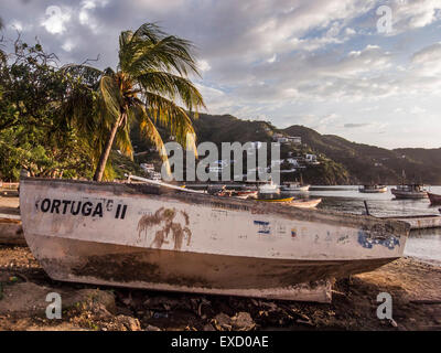 Fishing boat on the beach at Taganga, near Santa Marta, Colombia.  The once small fishing village on the Caribbean - Stock Photo