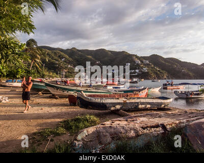 Sunset on the beach at Taganga near Santa Marta, Colombia.   The once small fishing village on the Caribbean has - Stock Photo