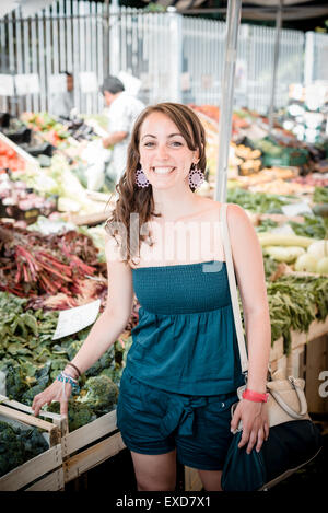 beautiful woman at the market shopping - Stock Photo