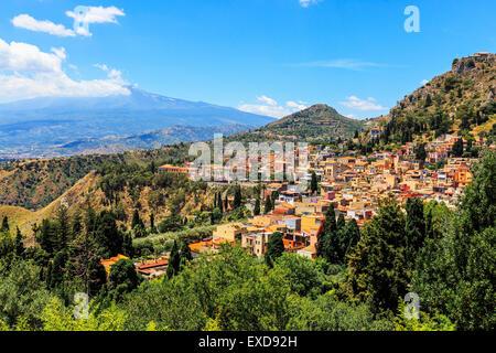 Village of Taormina and Mount Etna, Messina District, Sicily, Italy - Stock Photo