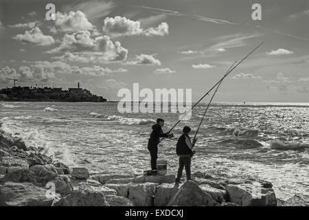 TEL AVIV, ISRAEL - MARCH 2, 2015: The fishing of boys on the seaside in Tel Aviv - Stock Photo
