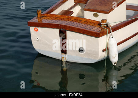 Small wooden rowing boat with polished wood - Stock Photo