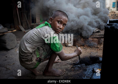Dhaka, Bangladesh. 12th July, 2015. A child works in a hazardous working condition in a Shipyard. Credit:  Mohammad - Stock Photo