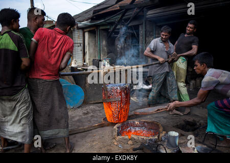 Dhaka, Bangladesh. 12th July, 2015. Laborers work in a hazardous working condition in a Shipyard. Credit:  Mohammad - Stock Photo