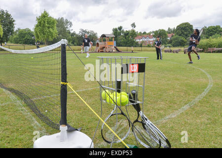 Hampstead Heath, London, UK. 12th July 2015. People playing T3 three a side tennis on Hampstead Heath © Matthew - Stock Photo