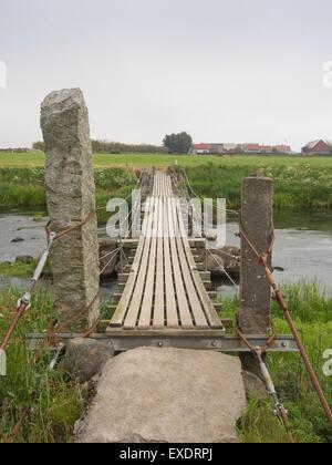 North Sea Cycle Route across Jaeren Norway, river Haa (Hå) , flat agricultural landscape, fog, narrow footbridge - Stock Photo