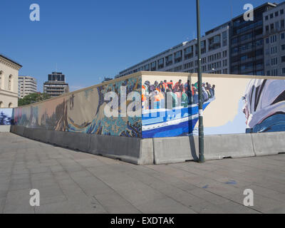 A long, temporary mural in Oslo Norway, Mare Nostrum , depicting the struggles of the boat refugees crossing the - Stock Photo