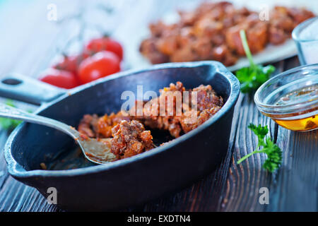 minced meat with tomato sauce in pan - Stock Photo