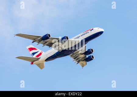Under a British Airways Airbus A380 aeroplane as it climbs out from London Heathrow - Stock Photo