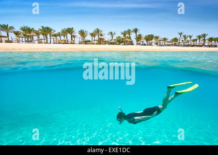 A young woman snorkeling underwater, Marsa Alam Reef, Red Sea, Egypt