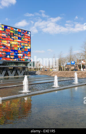 Street view with building and pond of the Netherlands Institute for Sound and Vision at Hilversum, the Netherlands - Stock Photo