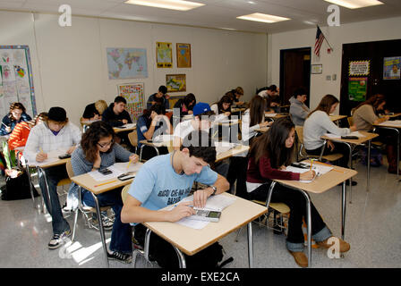 Students in high school classroom taking a standardized math test - Stock Photo
