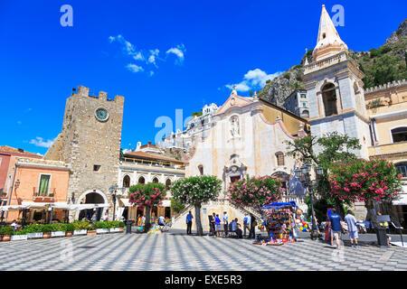 Borgo Medievale Clock tower and San Giuseppe Church  at IX Aprile Square, Corso Umberto, Taormina village, Sicily - Stock Photo