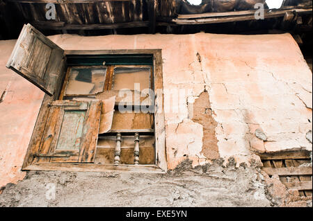 A window in an old derelict house in Turkey - Stock Photo