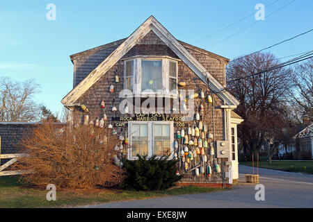 An old, weathered building housing a seafood restaurant, Orleans, Cape Cod, Massachusetts, United States, North - Stock Photo