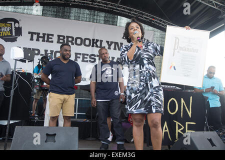 New York, USA. 11th July, 2015. Council Member Laurie Cumbo (R) presents Wes Jackson (L) founder of the Brooklyn - Stock Photo