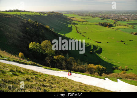 Painting the Westbury white horse (Bratton Camp hillfort). - Stock Photo