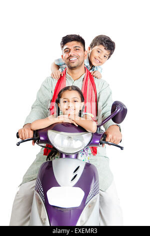 indian Rural  father with kids Riding Scooty - Stock Photo