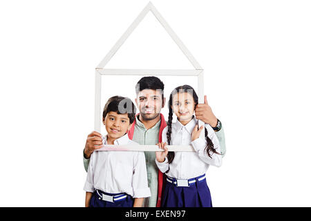 indian Rural  father with kids Frame House dreaming - Stock Photo