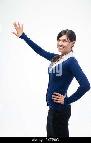 Happy businesswoman presenting something isolated on a white background - Stock Photo