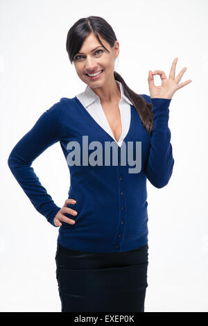 Happy beautiful businesswoman showing ok sign isolated on a white background. Looking at camera - Stock Photo