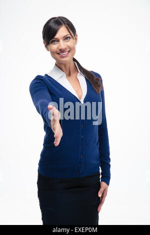 Portrait of a smiling businesswoman showing greeting gesture isolated on a white background. Looking at camera - Stock Photo