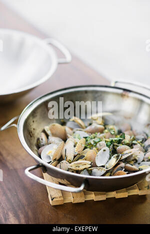 steamed mussels bulhao pato style with garlic and herb sauce in portuguese cataplana - Stock Photo