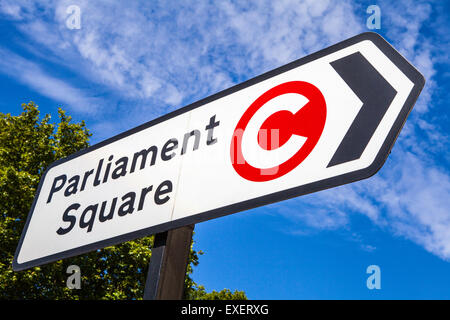 LONDON, UK - JULY 10TH 2015: A road sign pointing to the direction of Parliament Square and also displaying the - Stock Photo