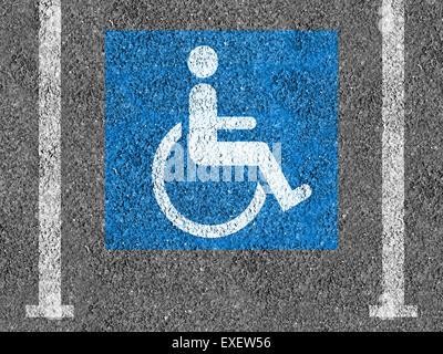 Blue and white Handicap parking symbol on asphalt - Stock Photo