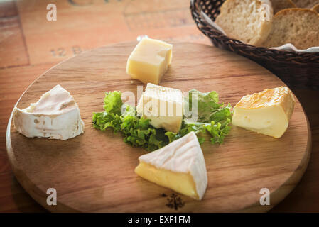 mixed traditional french cheese platter with bread - Stock Photo