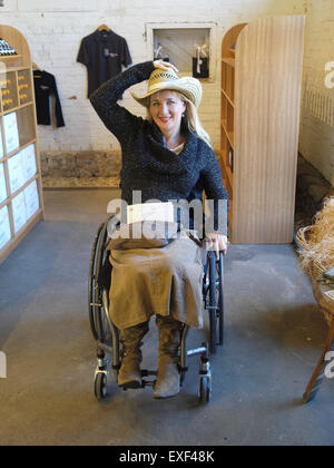 Woman in a wheelchair at a Yarra Valley Winery - Stock Photo