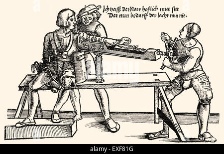 Arm extension on a stretching rack, orthopedic therapy, woodcut from 'Feldtbuch der Wundartzney' by Hans von Gersdorff, - Stock Photo