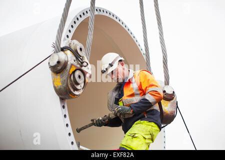 Engineer working on wind turbine - Stock Photo
