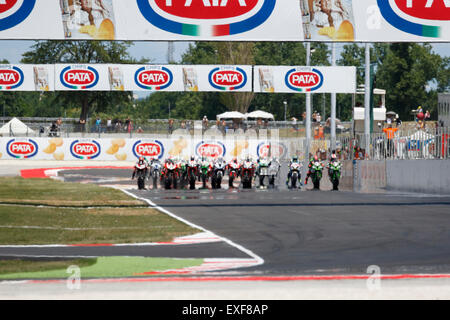 Misano Adriatico, Italy - June 21, 2015: Bikes prepare to leave the grid at the start during race one at the Superbike - Stock Photo
