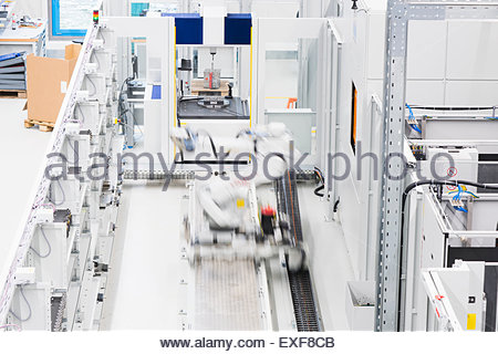 Industrial production line with moving automated robot - Stock Photo