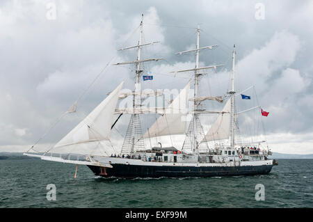 The Lord Nelson ship leaves Belfast during the start of the 2015 Tall Ships race - Stock Photo