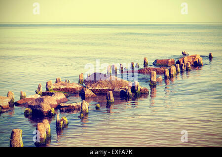 Retro vintage style photo of a beach, nature peaceful background. - Stock Photo