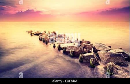 Vintage toned beautiful sea landscape after sunset. - Stock Photo