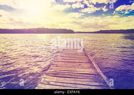 Vintage toned photo of beautiful sunset over lake, Ostromecko in Poland. - Stock Photo