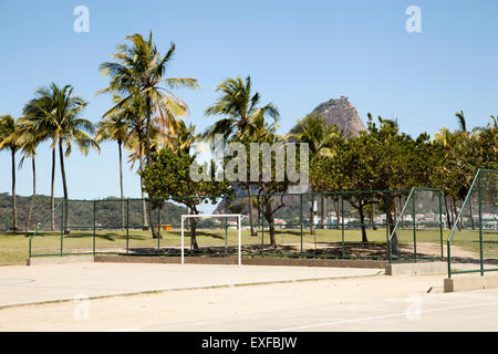 Empty basketball and soccer court in front of Sugarloaf mountain, Rio De Janeiro, Brazil - Stock Photo