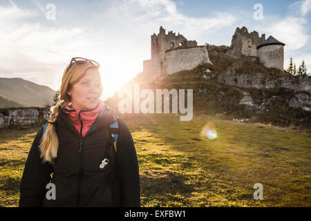 Young female hiker in front of Ehrenberg castle ruins, Reutte, Tyrol, Austria - Stock Photo