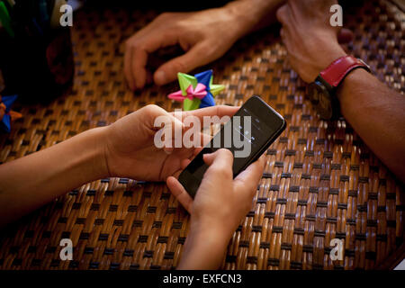 Students texting and relaxing, partial view of hands - Stock Photo