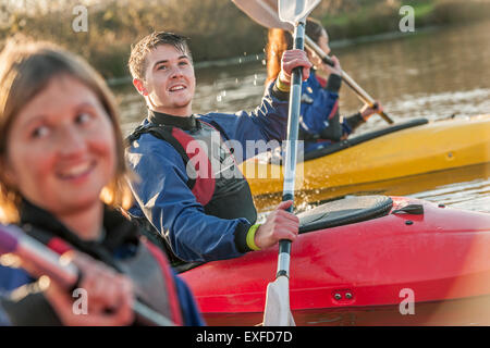 Young man and woman kayaking - Stock Photo