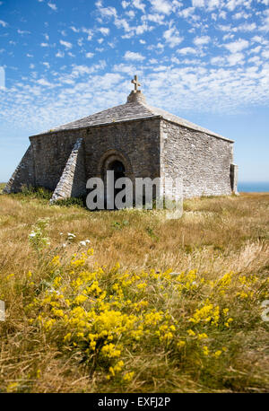 St Aldhelm's Chapel is a buttressed structure on the cliffs of St Aldhelm's head in Dorset built to withstand gale - Stock Photo