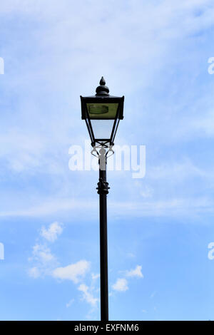 Vintage style street lamp against blue sky - Stock Photo