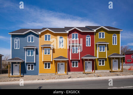 Four brand new colourful row houses on a sunny day in St. John's, Newfoundland. - Stock Photo