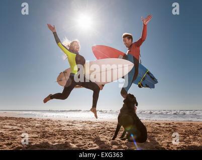 Couple of crazy surfers. El Palmar, Tarifa, Cadiz, Costa de la Luz, Andalusia, Southern Spain. - Stock Photo