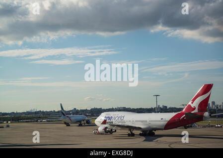 Sydney airport, Qantas one world aircraft, Australia - Stock Photo